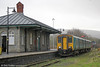 Network Rail won the 2017 Railway Heritage Trust Conservation Award in the Railway Heritage Trust Awards for its conservation work at Pantyffynnon Station. It is an example of an 1850s 'Brunel chalet' and this and the nearby signal box have a Grade 2 Listing.<br /> The restoration by Network Rail was lengthy and thorough and included a new roof covering, a new chimney, new doors and windows replicating the old and extensive stonework repairs, with unsympathetic modern extensions removed.<br /> The building had become very damp so lime plastering was reinstated on the internal walls and a ventilated limecrete floor was installed as these are materials that allow the building to 'breathe'. The reinstatement of the chimney provided an additional ventilation system allowing airflow and prevention of damp. 150235 calls forming 2M37, 1112 Swansea to Shrewsbury on 31st December 2017.