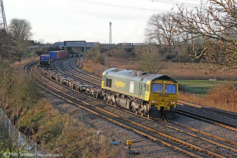FL 66524 passes Duffryn with 4O70, 0956 Wentloog to Southampton Maritime on 27th December 2017. The white panel on the side of the loco is a recruitment advert.