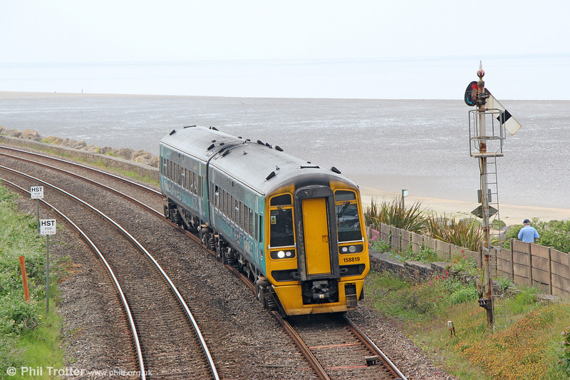 ATW 158819 Approaches Ferryside with 1V36, 0731 Crewe to Carmarthen on 9th June 2018.