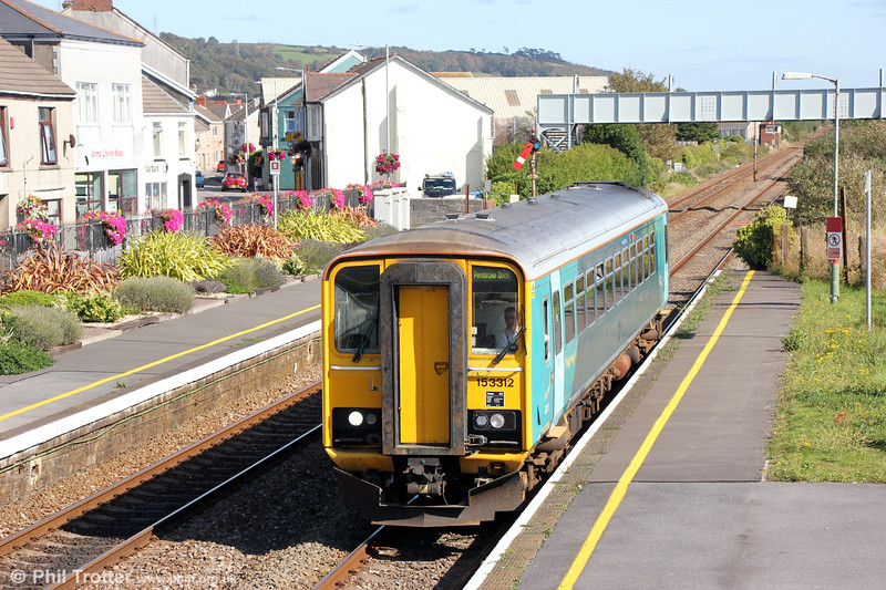 153312 calls at Pembrey and Burry Port forming 2E24, 1400 Swansea to Pembroke Dock on 17th September 2019.