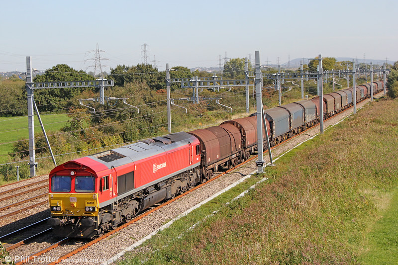 66097 passes Coedkernew with 6B10, 0850 Newport Docks to Margam on 20th September 2019.