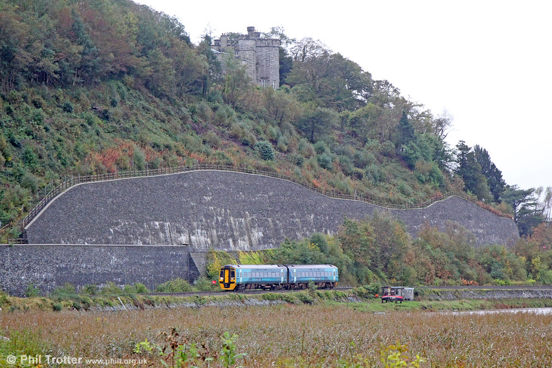 Birmingham International seems a world away from the remoteness of the Dovey estuary. Here, 158831 passes beneath Glandyfi Castle forming 1G35, 1130 Aberystwyth to Birmingham International on 11th October 2019.