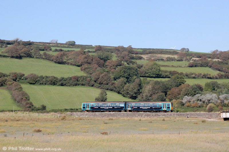 A class 143 forming 1B97, 1250 Fishguard Harbour to Cardiff Central approaches Kidwelly on 18th September 2019.