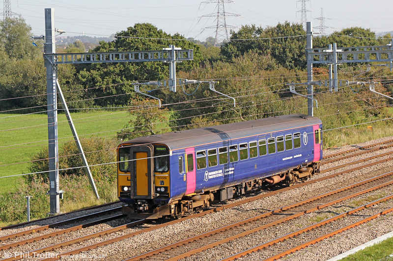 What colour's the train today, mum? Transferred from GWR, 153329 passes Coedkernew forming 2B96, 1040 Newport to Cardiff Central on 20th September 2019.