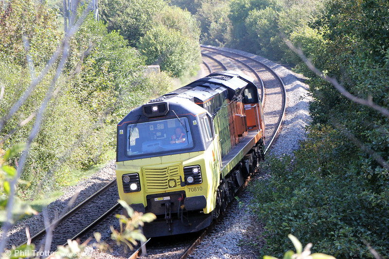 The undergrowth has taken over at Llangewydd, but there are signs that the Japanese Knotweed may be under ontrol. Colas 70810 passes, running as 0B54, 1156 Canton Sidings to Baglan Bay on 19th September 2019.