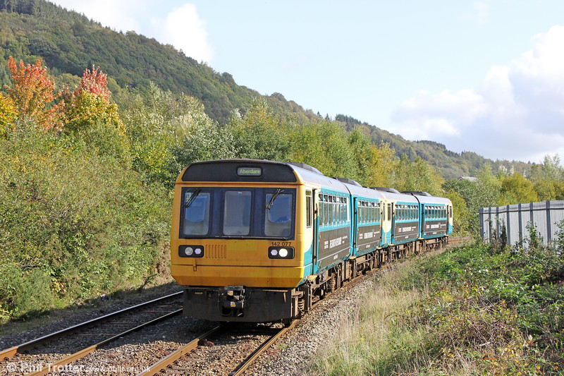 142077 and 142083 at Mountain Ash with 2A12, 1256 Barry Island to Aberdare on 6th October 2019.