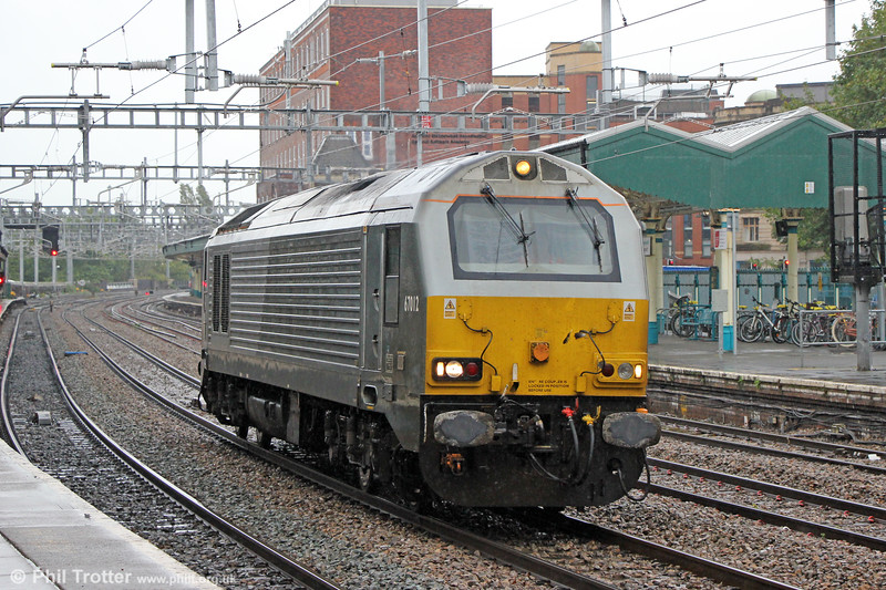 67012 passes Newport, running as 0V12, 1320 Crewe TMD to Cardiff Canton on 23rd September 2019.