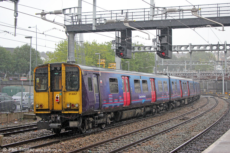Great Northern class 313 units (313030 & 313057) are towed through Newport for scrapping. The train was 5Q78, 1052 Hornsey EMU Depot to Newpoort Docks (Sims Group) on 23rd September 2019.