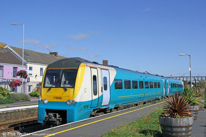 175008 calls at Pembrey and Burry Port forming 1V38, 0931 Manchester Piccadilly to Carmarthen on 17th September 2019.