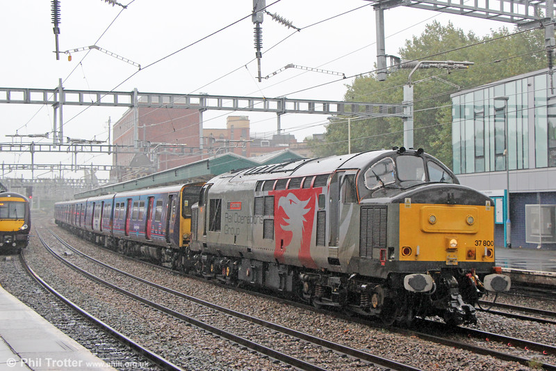 Scrap Metal: ROG 37800  'Cassiopeia' passes Newport with two Great Northern class 313 units (313030 & 313057) for scrapping. The train was 5Q78, 1052 Hornsey EMU Depot to Newpoort Docks (Sims Group) on 23rd September 2019.
