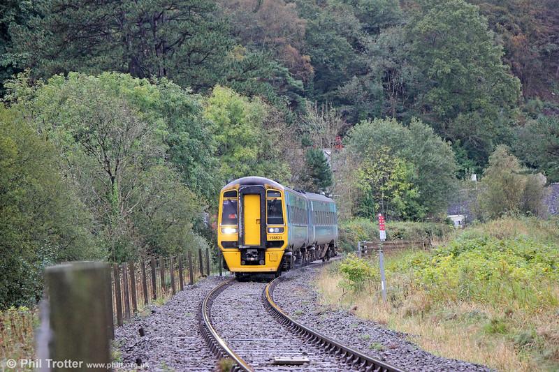 158831 near Glandyfi forming 1G35, 1130 Aberystwyth to Birmingham International on 11th October 2019.