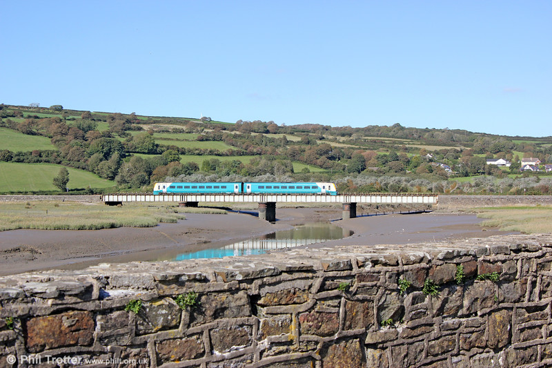 1V39, 1031 Manchester Piccadilly to Milford Haven crosses the Gwendraeth Fach at Kidwelly on 17th September 2019.