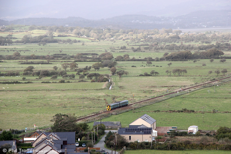 2J15, the 1456 Machynlleth to Pwllheli pulls away from Harlech on 8th October 2019.