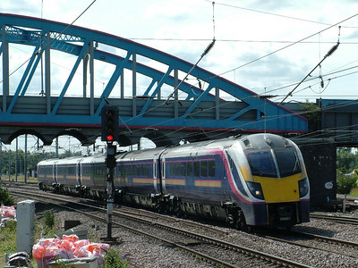 Grand Central's 180107, still in it's original First Great Western livery, heads North through Peterborough on the 31st July 2009