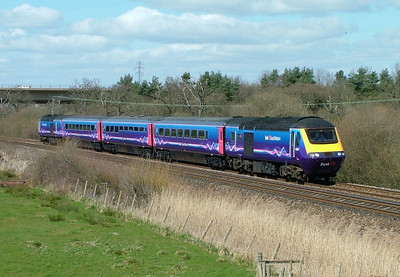 The launch special for First Great Western's new livery heads West past Exminster with 43004 and 43009 - the production version of the livery lost the graphics from the power cars as well as the colour fade in the main body colour