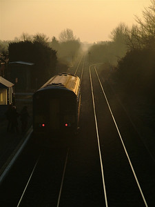 As the sun rises over Suffolk, 153309 calls at Trimley to pick up a couple of passenger for Felixstowe