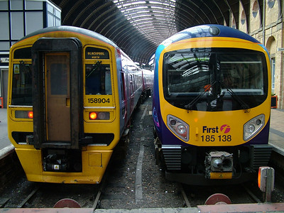 Northern Rail's 158904 and Trans Pennine Express's 185138 wait in the bay platforms at York on the 13th April 2007