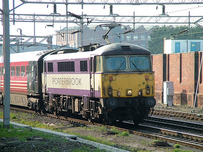 87002 wearing Porterbrook Leasing purple and silver passing Rugby on a Virgin West Coast service