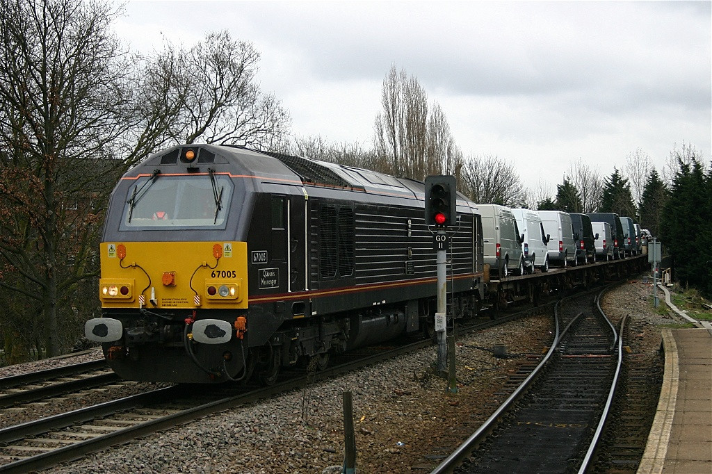Royal train liveried 67005 at Gospel Oak with loaded vehicle carriers from Ford at Dagenham