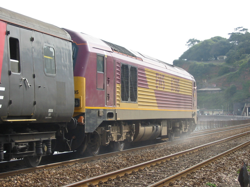 During summer 2004 Virgin Trains hired in loco hauled coaching stock sets using EWS class 67s as power, 67015 is seen at Dawlish