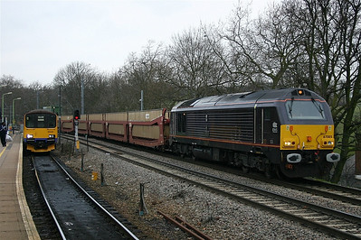 Royal train liveried 67005 at Gospel Oak with empty vehicle carriers for Dagenham, London Overground's 150128 waits in the bay platform.