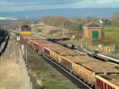 66100 rolls towards the Severn Tunnel at Pilning with a long rake of ZCA 'Sea Urchin' and 'Sea Hare' wagons on New Year's Eve 2004