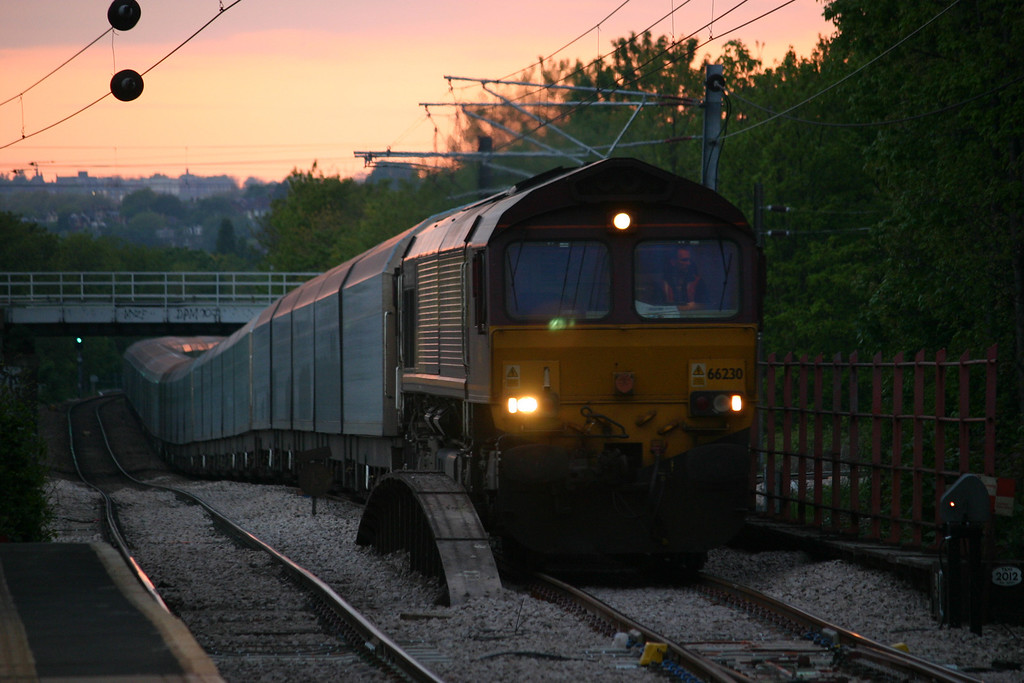 As the sun sets over North London 66230 approaches South Tottenham with export mini's from Cowley to Purfleet