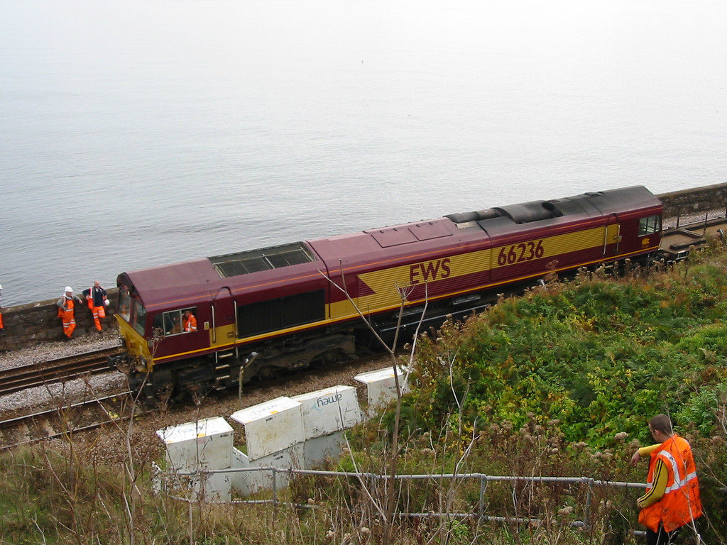 66236 at Horse Cove, Dawlish, with an engineers train, with a calm sea as a backdrop.