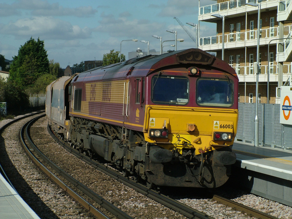 66003 at Imperial Wharf with a stone train