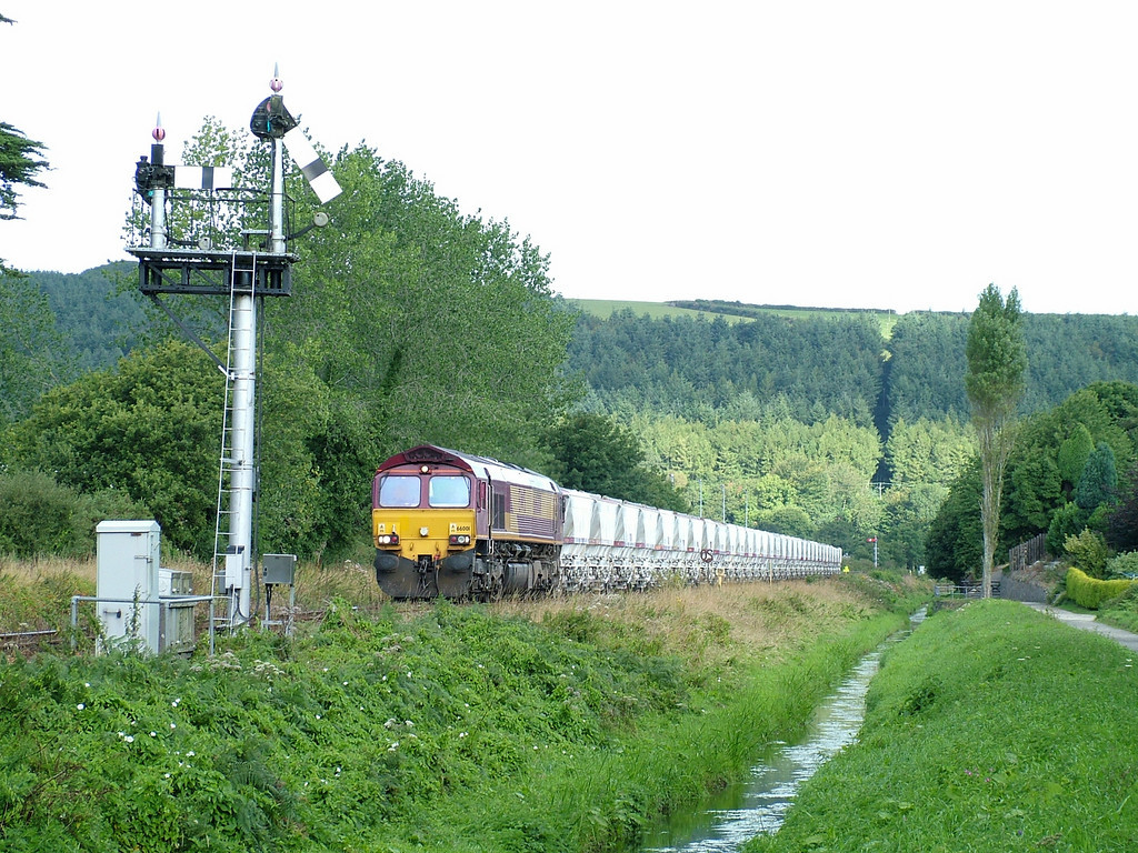 66001 approaches Middleway Crossing, St Blazey, with the 6G06 CDA clay loads to Fowey on the 23rd August 2005