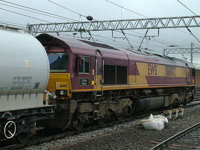 "66002 ""LaFarge Quorn"" at Carlisle with the Castle Cement empties"
