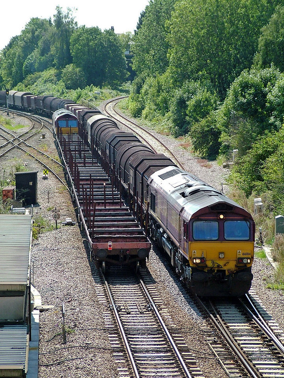66014 passing a class mate at Newport Gaer Jcn with a long train of steel coil carriers