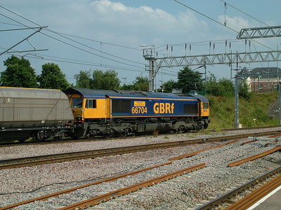 On hire to Fastline, GBRf's 66704 leads a coal train through Nuneaton on the 2nd July 2009