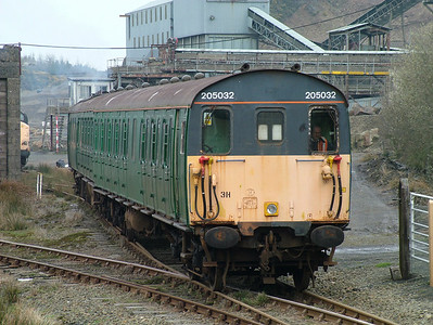 With a coat of Dartmoor Railway's green paint over the Connex liver on the sides, 205032 leaves the yard at Meldon Quarry on the 15th April 2006