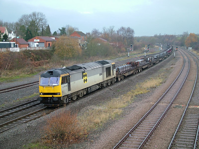 Coal sector liveried 60060 at a damp Clay Cross with a steel train, 26th November 2004