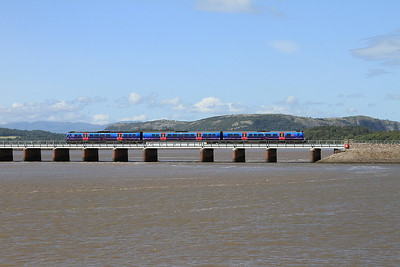 A class 185 crossing Kents Viaduct, Arnside - 04/07/15.