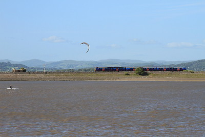 Kite surfer at Arnside ..... and a 185 leaving the station - 04/07/15.