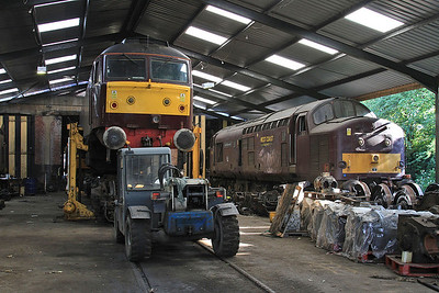 57001 (lifted off its bogies for maintenance) & 37676 (Stored) inside the diesel depot - 15/07/15.