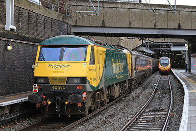 90043, London Euston, the stock ex 1M11 23.40 ex Glasgow C.......... 90043 worked the train Glasgow-Newcastle, was then dragged by 66720 via the Durham coast to Doncaster, then worked to Wembley, and was finally dragged into Euston by 86401 ! - 09/01/16.