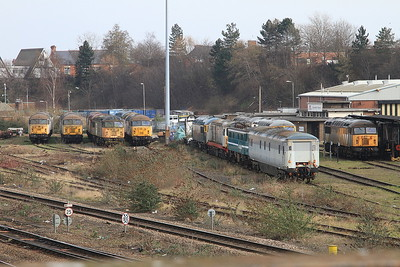 UKRL's depot at Leicester, with 56032, 56069, 56077, 56038, 56006, 58016, 86235, 56081 & 56301 visible - 27/02/16.