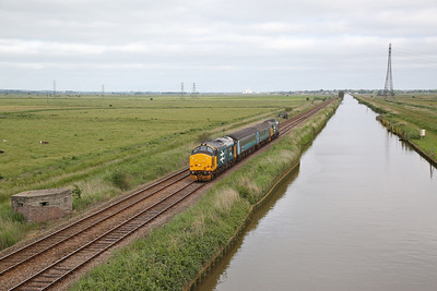 37424 (37407 rear) approaching Haddiscoe and running alongside the New Cut connecting the rivers Waveney at Haddiscoe to the Yare at Reedham, 5J67 06.40 Norwich Crown Point-Lowestoft ECS - 27/06/19