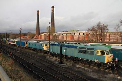 (L to R) 20306 / D213 / D4092 / 37275 / 07013 / 82008 / 73117 / 84001 / 56006 (with 40145 behind) lined up in the yard at BH - 04/12/2011.