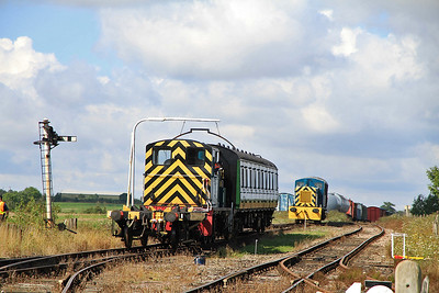 03399 shunts it's DMU trailer into the sidings after working a shuttle, 03081 waits to come into the platform to form the next service - 27/08/11.