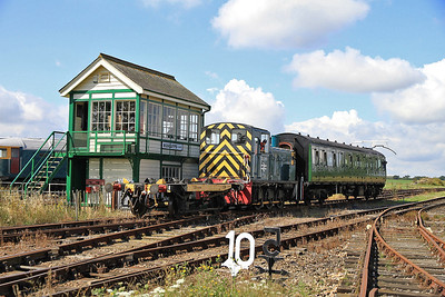 03399 shunts it's DMU trailer into the sidings after working shuttles - 27/08/11.