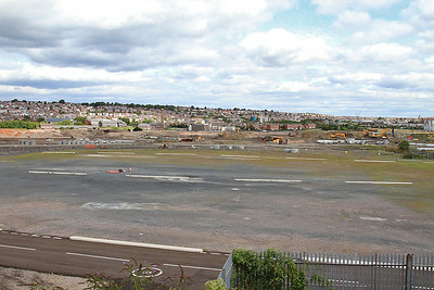 The site of Dai Woodhams scrapyard - just wasteland mainly these days - 16/08/14.