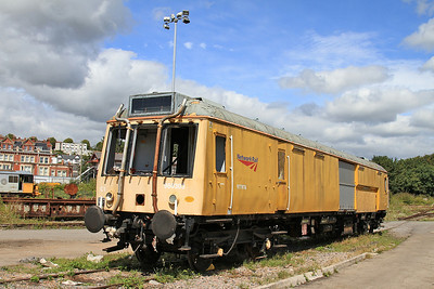 960303 (ex 977976 / 55031) sits in the yard outside Barry Shed - 16/08/14.