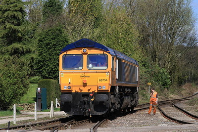 66754, having performed on the shuttles, runs off to the sidings - 18/04/15.