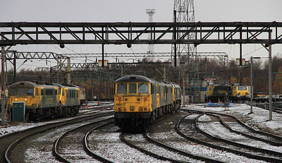 Freightliner locos in Crewe Basford Hall Yard, on left 86637 / 90045, in centre 86612 / 90041 / 86632 / 66543, on right 70003 is just arriving - 17/12/11.