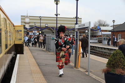 A bagpiper greets the very belated arrival of 1Z27 at Cleethorpes after a points farce at Marsh Jctn. - 02/04/11