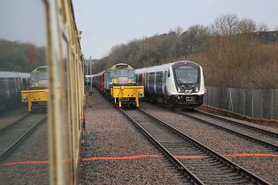 67005 leads 1Z82 towards the end of the line at Asfordby, 47714 can be seen ahead, next to a new Crossrail EMU here for testing - 29/12/17.